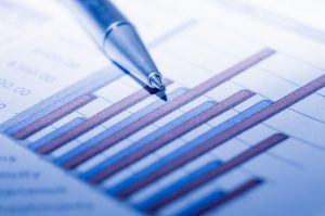 Close-up of business documents with ballpoint.