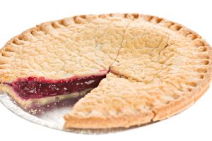 """A  high angle close up of a berry pie with a slice missing, the pie is in a tin baking plate."""